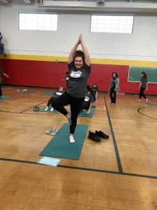 Student demonstrating a yoga pose.