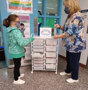 photo of mobile makerspace with student and teacher